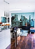 Large photo wallpaper element with cityscape motif in modern interior with rustic wooden floor
