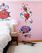 Girl's bedroom with tattoo murals and skateboard next to bedside table