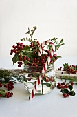 Posy of holly berries and candy cane