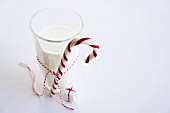 Parcel ornament next to glass of milk with candy cane