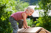 Germany, Girl playing on playground