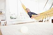 Germany, Bavaria, Munich, Woman relaxing in hammock