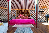 King sized double bed in a luxurious traditional Mongolia yurt or tend, in a holiday resort