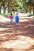 Two children playing on a path