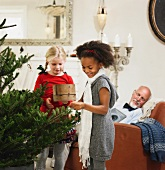 Girls decorating Christmas tree