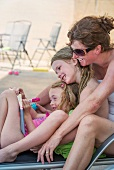 Mother and children relaxing outdoors