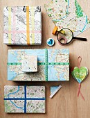 Imaginative gift wrap and three-dimensional heart-shaped pendant made from old maps and street maps