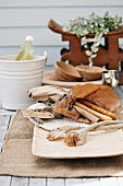 Paper bag of bread sticks and refreshing drink in white bucket on wooden table