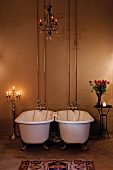 Antique bathtubs in candlelight