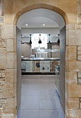 View into kitchen though arched stone doorway (Brasenose College, Oxford, England)