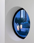 View into courtyard though round window (Pollen House, London, England)