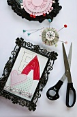 Craft idea for picture frames: cut-out fabric letters (collage)