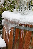 Snowy and icy wooden tub