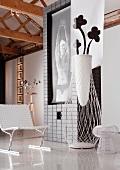 Detail of room with mural, designer chair, floor vase and objet d'art