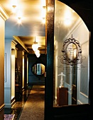 Stylish hallway with antiques and wall mirror (Hotel De Ville)