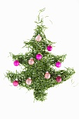 Christmas tree made of pine needles decorated with violet baubles