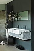 Designer bathroom - washstand with twin basins and stone base in niche painted dark grey