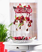 Christmas mobile with red tulips, apples and baubles