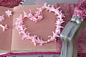 Heart-shaped wreath of pink hyacinth florets on handmade paper