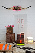 Bull horns on pink panel on wall above New Year 2013 arrangement with neon accents