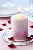 Pillar candle decorated with glitter