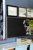 Bulletin board and picture collection above a narrow desk