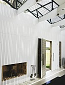 Lobby of a modern home with a loft-like feel achieved with lightweight framing with light and shadow play