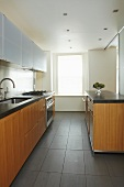 Functional, modern kitchen with wooden base unit fronts and white wall unit doors