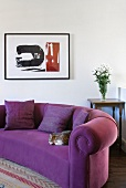 Purple sofa with spiral in upholstery of rolled arm in modern setting
