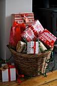 Wrapped Christmas presents in wicker basket