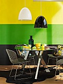 Contrasting colour scheme in snazzy breakfast area with designer furniture