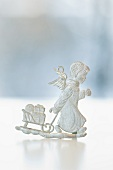 A pewter Christmas figurine: a Christmas angel with a sleigh