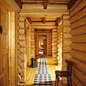 Corridor with black and white checked runner on floor in log cabin