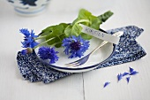 A place setting with cornflowers and a name card