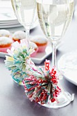Pompoms made from paper cake cases decorating glasses of sparkling wine