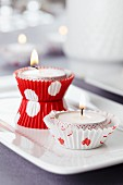 Candle arrangement; paper cake cases used as tealight holders