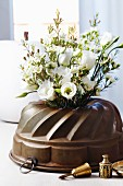 Bundt tin used as vase for lisianthus & waxflowers