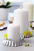 Tart tins used as candle holders decorated with waxflowers & mimosa flowers