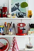 Colourful utensils on white kitchen shelves