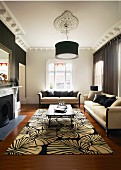 Traditional living room with black and white floral rug and elegant sofa set