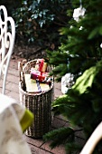 Small Christmas presents in wicker basket