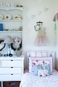 Corner of girl's bedroom in romantic decor