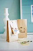 Paper bags decorated with small drawings used as gift packaging