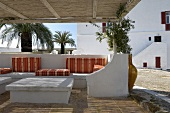 Veranda with soft cushions on masonry furniture