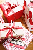 Christmas presents wrapped in red and white paper and ribbons