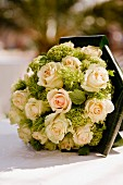 Elegant bridal bouquet with salmon roses
