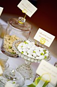 Various flavours of sugared almonds for wedding favours in glass containers