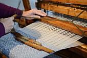 Weaver working on a loom