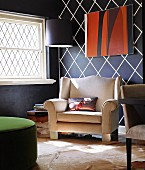 Inviting armchair in interior with striking black and white wall design
