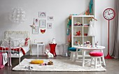 Child's bedroom in white with red accessories, snowflake lamp and station clock